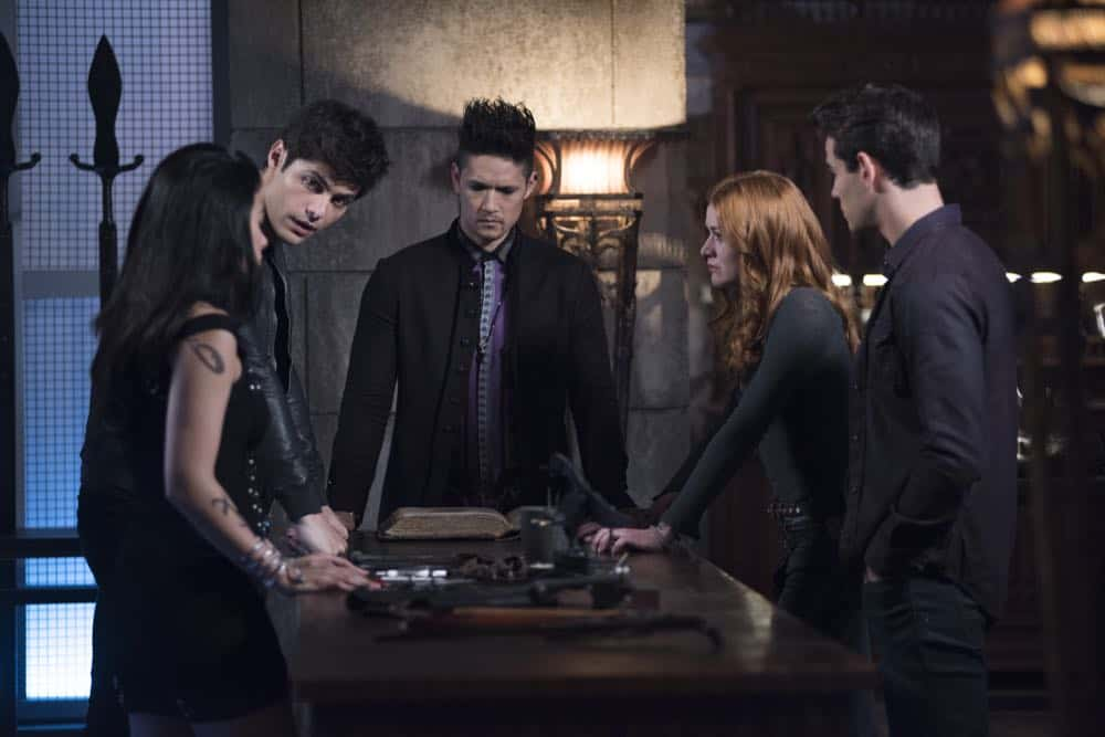 "SHADOWHUNTERS - ""Salt In The Wound"" - With the Owl's identity revealed, Alec, Isabelle, and Clary head to Alicante to try and find a way to stop him. Luke and Simon team up to track Lilith's  latest possible victim. Maia reflects on her past. This episode of ""Shadowhunters"" airs Tuesday, May 1 (8:00 - 9:00 p.m. EDT) on Freeform. (Freeform/John Medland) EMERAUDE TOUBIA, MATTHEW DADDARIO, HARRY SHUM JR., KATHERINE MCNAMARA, ALBERTO ROSENDE"