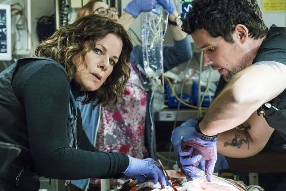 """Third Year"" -- A drug bust-turned-shootout tests the bravery of the doctors of Angels Memorial as they race to save a girl caught in the crossfire. Also, Willis (Rob Lowe) shifts his focus to field medicine, choosing to work primarily on an ambulance with his new partner, paramedic Rox (Moon Bloodgood). And Leanne (Marcia Gay Harden) begins her journey to adopt Ariel (Emily Alyn Lind), on the third season premiere of CODE BLACK, Wednesday, April 25 (10:00-11:00PM, ET/PT) on the CBS Television Network.  Pictured: Marcia Gay Harden (Dr. Leanne Rorish), Benjamin Hollingsworth (Dr. Mario Savetti)  Photo: Monty Brinton/CBS ©2017 CBS Broadcasting, Inc. All Rights Reserved"