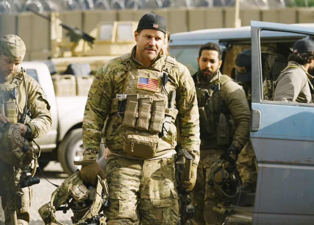 """Takedown"" -- The SEAL Team sends Ray undercover in a busy spice market to make a high stakes money swap, and Jason attempts to take down a terrorist known to wear a suicide belt. Also, Ray realizes the devastating consequences of his decisions, on SEAL TEAM, Wednesday, April 25 (9:01-10:00 PM, ET/PT) on the CBS Television Network. Pictured L to R: Max Thieriot as Clay Spenser, Dadiv Boreanaz as Jason hayes and Neil Brown Jr. as Ray Perry. Photo: Aaron Epstein/CBS ©2018 CBS Broadcasting, Inc. All Rights Reserved"