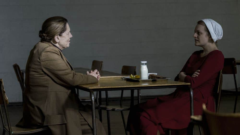 "THE HANDMAID'S TALE -- ""June"" -- Episode 201 -- Offred reckons with the consequences of a dangerous decision while haunted by memories from her past and the violent beginnings of Gilead. Aunt Lydia (Ann Dowd) and Offred (Elisabeth Moss), shown. (Photo by:George Kraychyk/Hulu)"