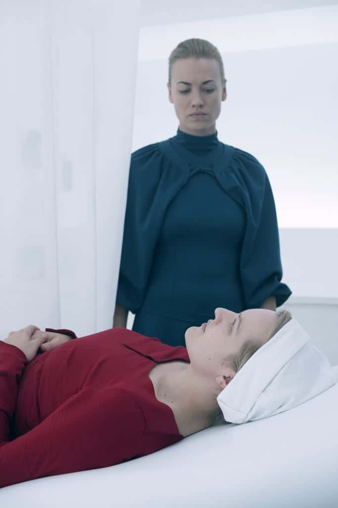 "THE HANDMAID'S TALE -- ""June"" -- Episode 201 -- Offred reckons with the consequences of a dangerous decision while haunted by memories from her past and the violent beginnings of Gilead. Serena Joy (Yvonne Strahovski) and Offred (Elisabeth Moss), shown. (Photo by:George Kraychyk/Hulu)"