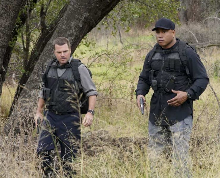 """Reentry"" - Pictured: Chris O'Donnell (Special Agent G. Callen) and LL COOL J (Special Agent Sam Hanna). Callen, Sam and Nell travel to the Angeles Forest to search for pieces of a failed rocket launch, including a top-secret government device. Also, Hetty tries to help Keane (Jeff Kober) acclimate to life in the states, on NCIS: LOS ANGELES, Sunday, April 29 (9:00-10:00 PM, ET/PT) on the CBS Television Network. Photo: Bill Inoshita/CBS ©2018 CBS Broadcasting, Inc. All Rights Reserved."
