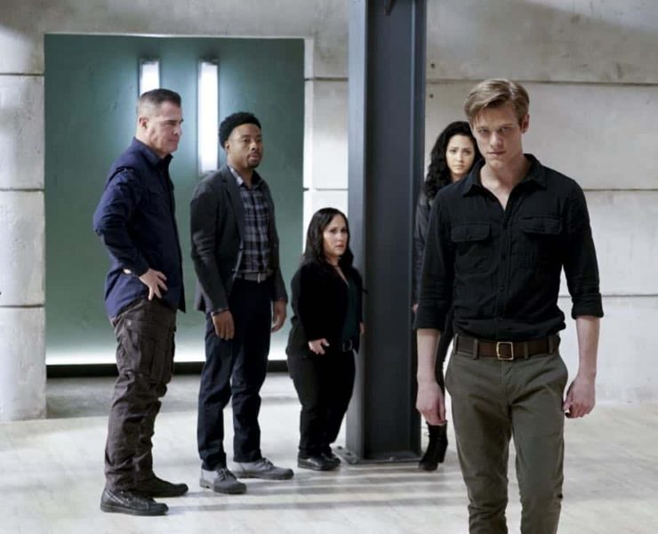 """""""MacGyver + MacGyver"""" -- MacGyver gets a shocking surprise when he tries to tell Matty that he's quitting the Phoenix Foundation, on the second season finale of MACGYVER, Friday, May 4 (8:00-9:00 PM, ET/PT) on the CBS Television Network. Tate Donovan guest stars as Oversight, a man with a history with Matty.Pictured: George Eads, Justin Hires, Meredith Eaton, Tristin Mays, Lucas Till. Photo: Jace Downs/CBS ©2018 CBS Broadcasting, Inc. All Rights Reserved"""
