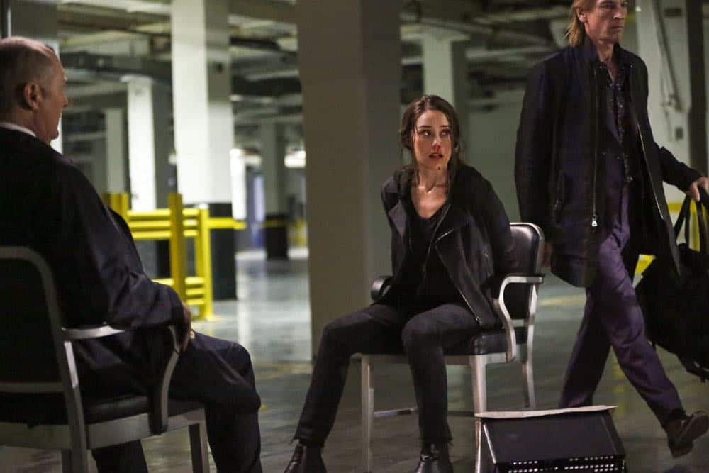 "THE BLACKLIST -- ""Sutton Ross (#17)"" Episode 522 -- Pictured: (l-r) James Spader as Raymond ""Red"" Reddington, Megan Boone as Elizabeth Keen, Julian Sands as Sutton Ross -- (Photo by: Will Hart/NBC)"