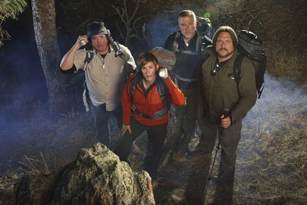 Matt Moneymaker, James 'Bobo' Fay, Cliff Barackman and Ranae Holland of Discovery's Finding Bigfoot in the woods of Colorado with flashlights and cameras.