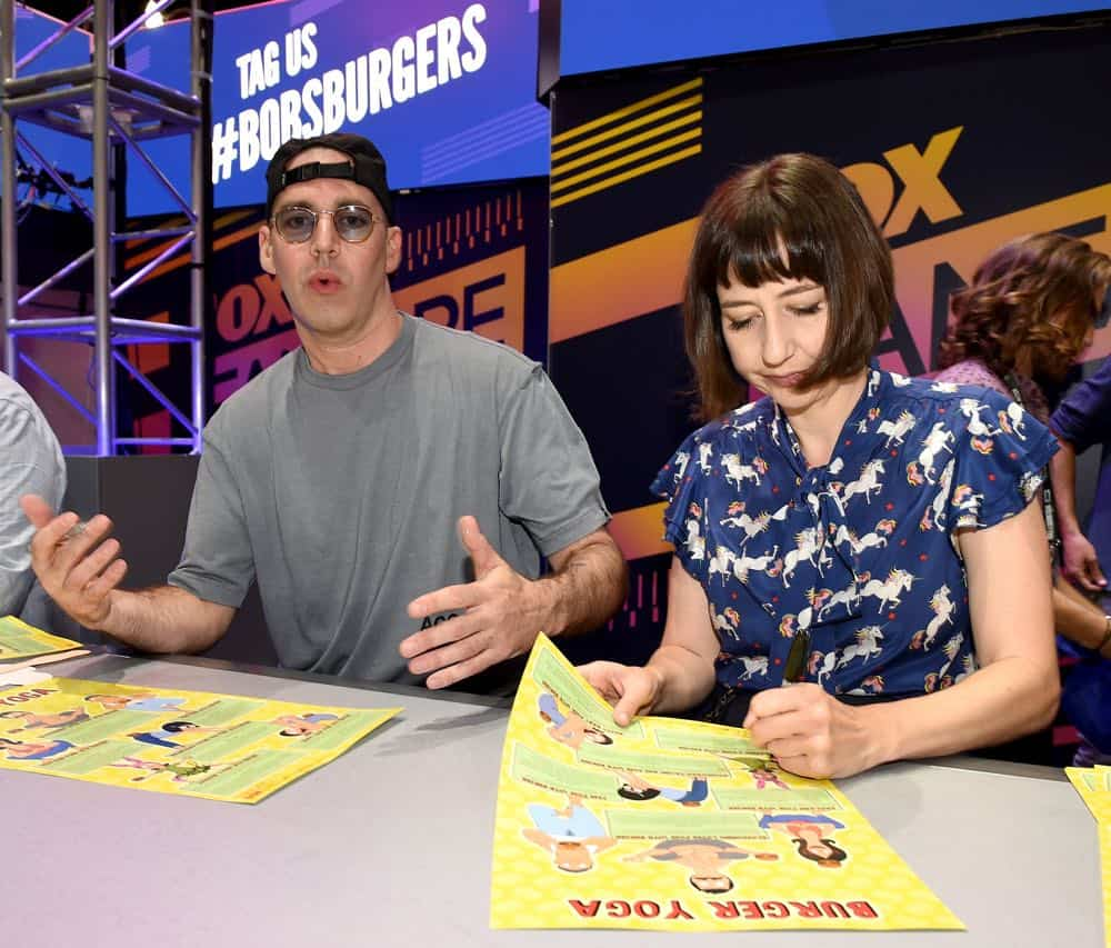 FOX FANFARE AT SAN DIEGO COMIC-CON © 2018: L-R: Cast members John Roberts and Kristen Schaal during the BOB'S BURGERS booth signing on Friday, July 20 at the FOX FANFARE AT SAN DIEGO COMIC-CON © 2018. CR: Frank Micelotta/FOX © 2018 FOX BROADCASTING