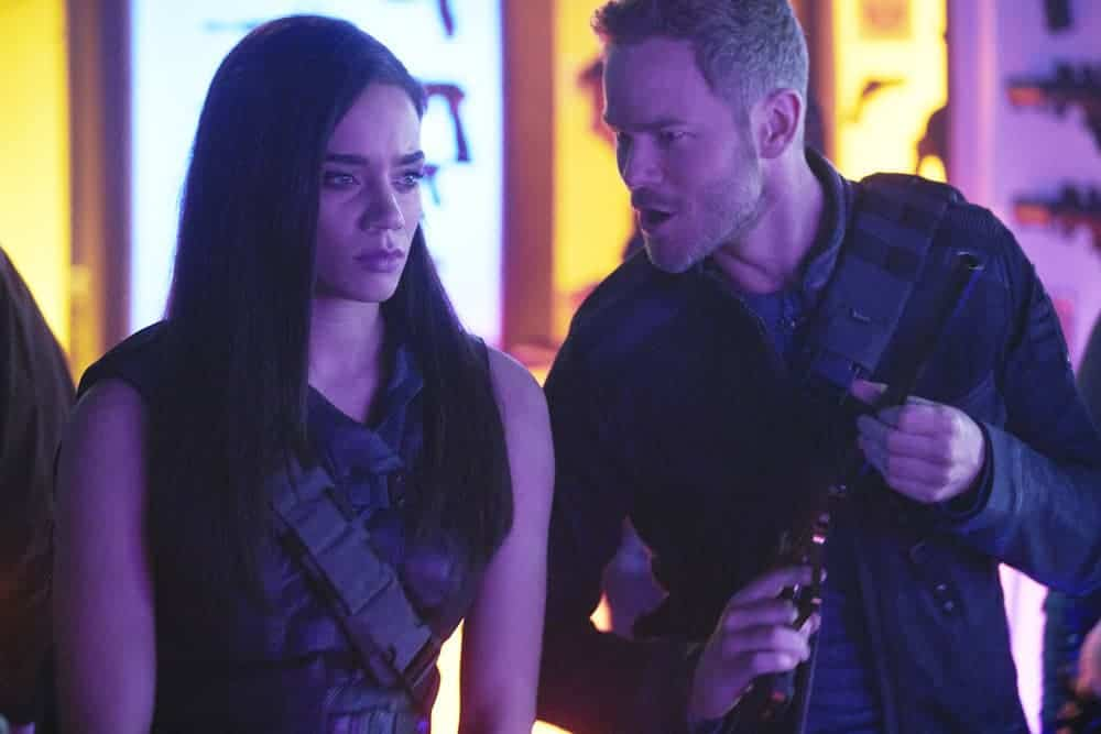 "KILLJOYS -- ""Greening Pains"" Episode 405 -- Pictured: (l-r) Hannah John-Kamen as Dutch, Aaron Ashmore as John -- (Photo by: Ian Watson/Killjoys IV Productions Limited/SYFY)"