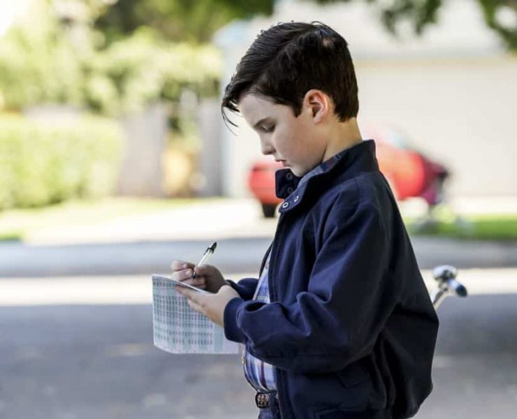 """""""A High-Pitched Buzz and Training Wheels"""" - Pictured: Sheldon (Iain Armitage). After Sheldon dismantles the refrigerator to stop an annoying hum, he gets a paper route to pay for the repairs, on the second season premiere of YOUNG SHELDON, on a special night, Monday, Sept. 24 (8:31-9:01 PM, ET/PT) on the CBS Television Network. Photo: Bill Inoshita/CBS ©2018 CBS Broadcasting, Inc. All Rights Reserved."""
