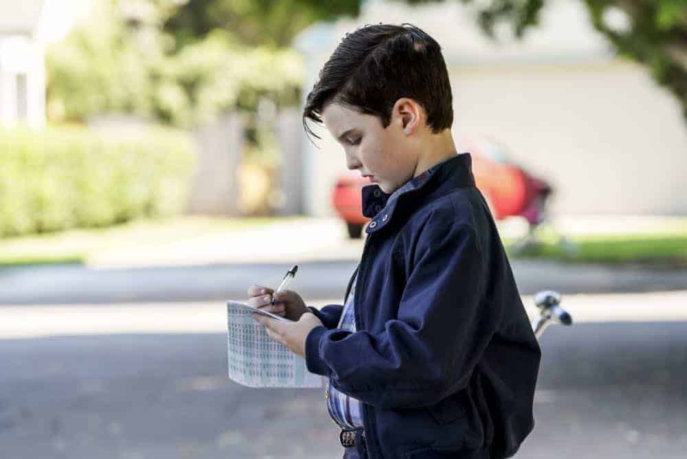 """A High-Pitched Buzz and Training Wheels"" - Pictured: Sheldon (Iain Armitage). After Sheldon dismantles the refrigerator to stop an annoying hum, he gets a paper route to pay for the repairs, on the second season premiere of YOUNG SHELDON, on a special night, Monday, Sept. 24 (8:31-9:01 PM, ET/PT) on the CBS Television Network. Photo: Bill Inoshita/CBS ©2018 CBS Broadcasting, Inc. All Rights Reserved."