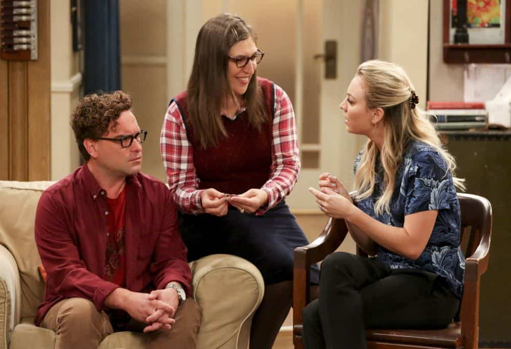"""The Wedding Gift Wormhole"" -- Pictured: Leonard Hofstadter (Johnny Galecki), Amy Farrah Fowler (Mayim Bialik) and Penny (Kaley Cuoco). Sheldon and Amy drive themselves crazy trying to figure out what ""perfect gift"" Leonard and Penny gave them for their wedding. Also, Koothrappali decides he wants to settle down and asks his father to arrange a marriage for him, on THE BIG BANG THEORY, when it moves to its regular time slot, Thursday, Sept. 27 (8:00-8:31 PM, ET/PT) on the CBS Television Network. Photo: Michael Yarish/CBS ©2018 CBS Broadcasting, Inc. All Rights Reserved."