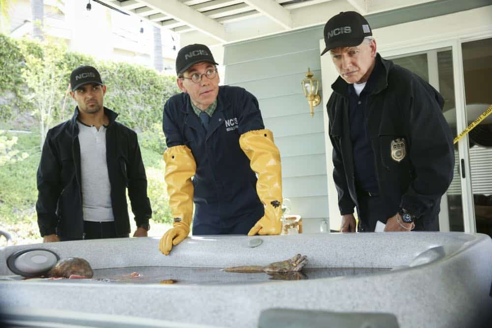 """Love Thy Neighbor"" - After a Navy lieutenant is found murdered in his hot tub, the team interviews several families in the victimÕs peculiar neighborhood. Also, Torres must face the consequences after a volatile night out with Palmer, on NCIS, Tuesday, Oct. 2 (8:00-9:00 PM, ET/PT) on the CBS Television Network. Pictured: Wilmer Valderrama, Brian Dietzen, Mark Harmon. Photo: Michael Yarish/CBS ©2018 CBS Broadcasting, Inc. All Rights Reserved"