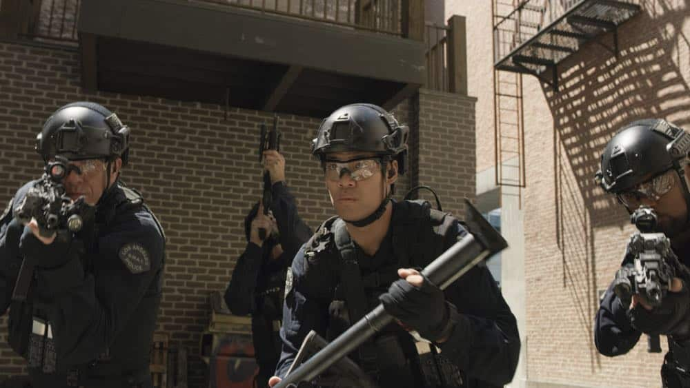 """Shaky Town"" -- The SWAT team engages in a standoff with human traffickers holding child hostages when a major earthquake hits Los Angeles during their operation and compromises the takedown. Also, while Hondo forms an unexpected personal connection with Deputy District Attorney Nia Wells (Nikiva Dionne), Jim Street has trouble adjusting to his new life as a patrol officer, on the second season premiere of S.W.A.T., Thursday, Sept. 27 (10:00-11:00 PM, ET/PT) on the CBS Television Network. Pictured L toR : Kenny Johnson as Dominique Luca, David Lim as Victor Tan and Shemar Moore as Daniel ""Hondo"" Harrelson. Photo: Screengrab/CBS ©2018 CBS Broadcasting, Inc. All Rights Reserved"
