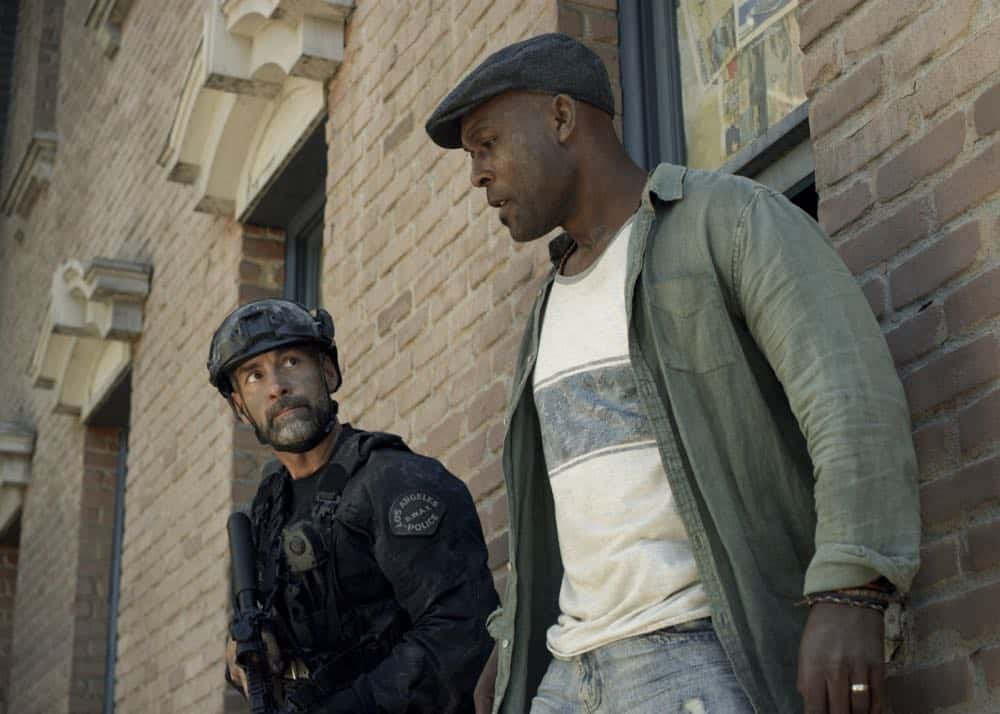 """Shaky Town"" -- The SWAT team engages in a standoff with human traffickers holding child hostages when a major earthquake hits Los Angeles during their operation and compromises the takedown. Also, while Hondo forms an unexpected personal connection with Deputy District Attorney Nia Wells (Nikiva Dionne), Jim Street has trouble adjusting to his new life as a patrol officer, on the second season premiere of S.W.A.T., Thursday, Sept. 27 (10:00-11:00 PM, ET/PT) on the CBS Television Network. Pictured: Jay Harrington as David ""Deacon"" Kay and E.R. Ruiz as Jax. Photo: Screengrab/CBS ©2018 CBS Broadcasting, Inc. All Rights Reserved"
