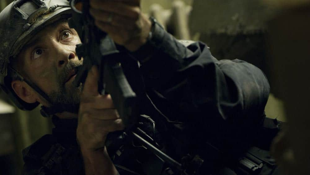 """""""Shaky Town"""" -- The SWAT team engages in a standoff with human traffickers holding child hostages when a major earthquake hits Los Angeles during their operation and compromises the takedown. Also, while Hondo forms an unexpected personal connection with Deputy District Attorney Nia Wells (Nikiva Dionne), Jim Street has trouble adjusting to his new life as a patrol officer, on the second season premiere of S.W.A.T., Thursday, Sept. 27 (10:00-11:00 PM, ET/PT) on the CBS Television Network. Pictured: Jay Harrington as David """"Deacon"""" Kay. Photo: Screengrab/CBS ©2018 CBS Broadcasting, Inc. All Rights Reserved"""