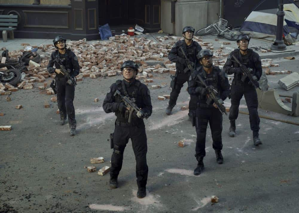 """""""Shaky Town"""" -- The SWAT team engages in a standoff with human traffickers holding child hostages when a major earthquake hits Los Angeles during their operation and compromises the takedown. Also, while Hondo forms an unexpected personal connection with Deputy District Attorney Nia Wells (Nikiva Dionne), Jim Street has trouble adjusting to his new life as a patrol officer, on the second season premiere of S.W.A.T., Thursday, Sept. 27 (10:00-11:00 PM, ET/PT) on the CBS Television Network. Pictured L to R: Lina Esco as Christina """"Chris"""" Alonso, Kenny Johnson as Dominique Luca, Shemar Moore as Daniel """"Hondo"""" Harrelson and David Lim as Victor Tan. Photo: Screengrab/CBS ©2018 CBS Broadcasting, Inc. All Rights Reserved"""