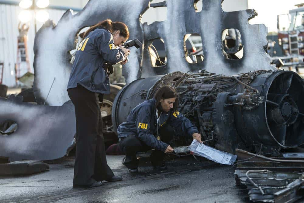 "MANIFEST -- ""Reentry"" Episode 102 -- Pictured: (l-r) FBI Agents Surveying Scene -- (Photo by: Peter Kramer/NBC)"