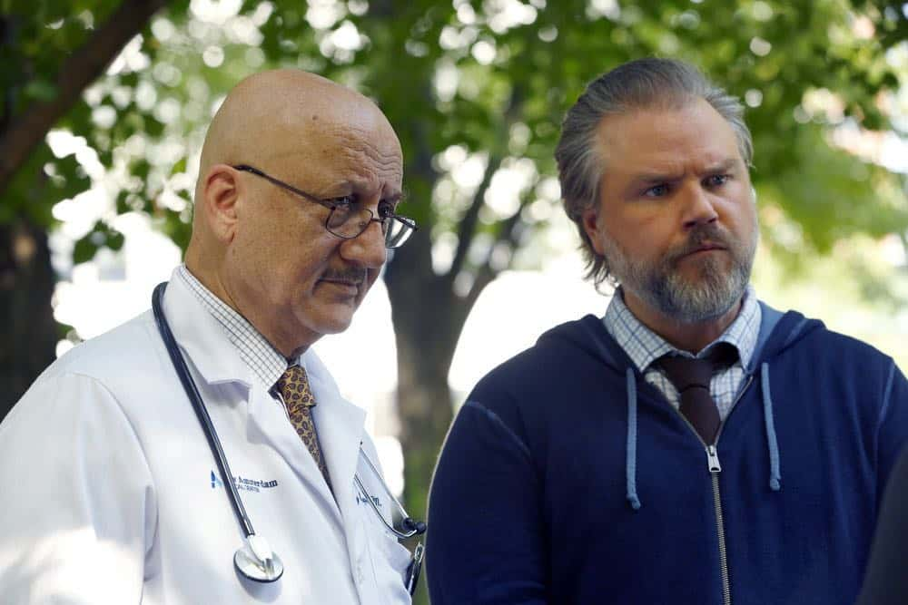 "NEW AMSTERDAM -- ""Rituals"" Episode 102 -- Pictured: (l-r) Anupam Kher as Dr. Vijay Kapoor, Tyler Labine as Dr. Iggy Frome -- (Photo by: Will Hart/NBC)"