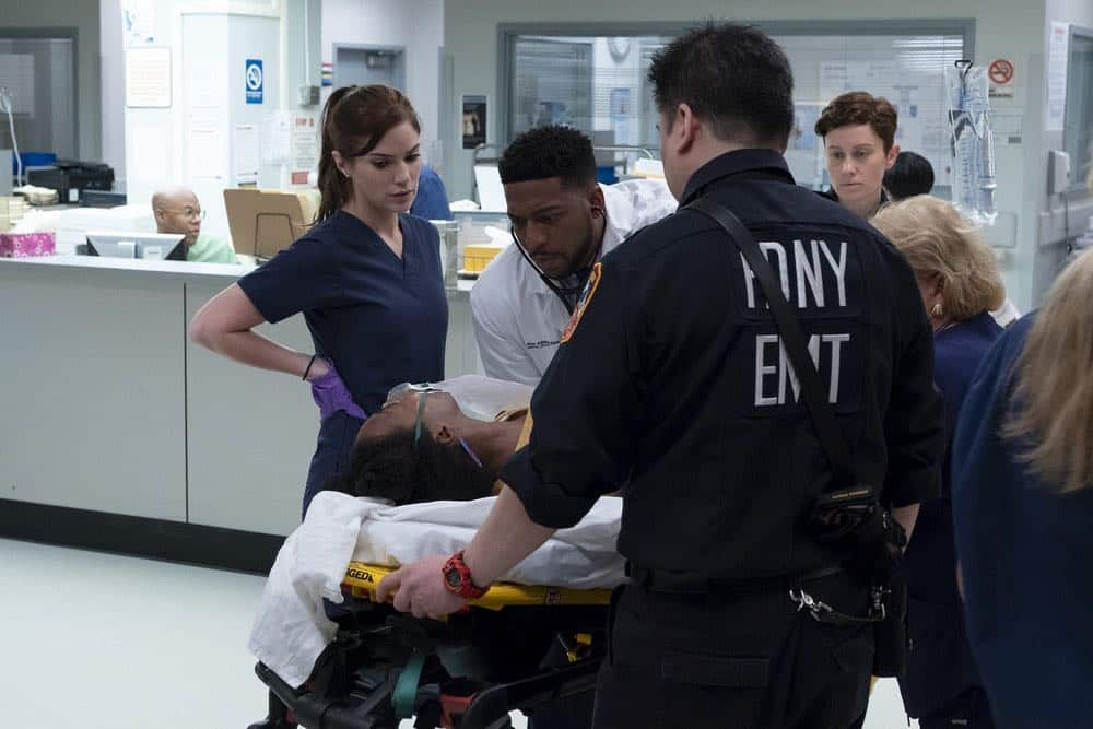 "NEW AMSTERDAM -- ""Rituals"" Episode 102 -- Pictured: (l-r) Janet Montgomery as Dr. Lauren Bloom, Jocko Sims as Dr. Floyd Reynolds -- (Photo by: Francisco Roman/NBC)"