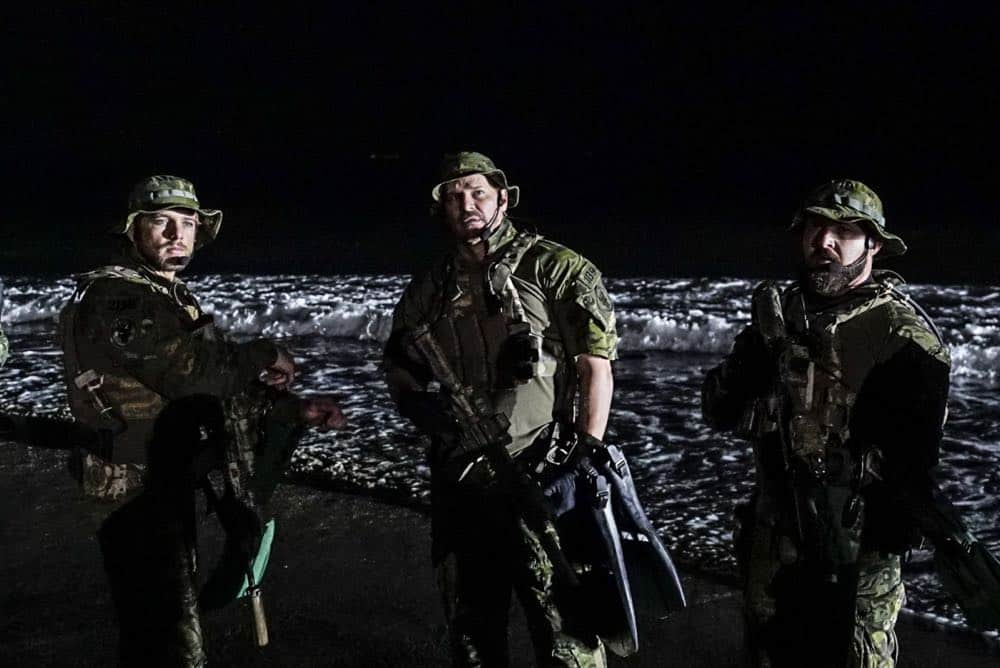 """Fracture"" -- Jason and Bravo Team head to the Gulf of Guinea to rescue American hostages after an oil platform is overtaken by armed militants, on the second season premiere of SEAL TEAM, Wednesday, Oct. 3 (9:00-10:00 PM, ET/PT) on the CBS Television Network. Pictured L to R: Max Thieriot as Clay Spenser, David Boreanaz as Jason Hayes and AJ Buckley as Sonny Quinn. Photo: Monty Brinton/CBS ©2018 CBS Broadcasting, Inc. All Rights Reserved"
