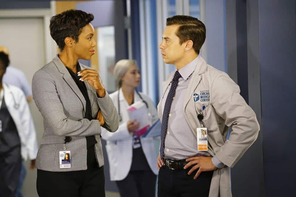 "CHICAGO MED -- ""Heavy Is The Head"" Episode 403 -- Pictured: (l-r) Heather Headley as Gwen Garrett, Nate Santana as Jimmy Lanik -- (Photo by: Elizabeth Sisson/NBC)"