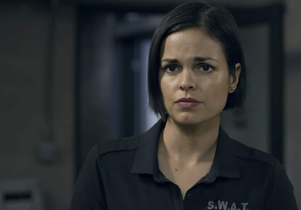 """Fire and Smoke"" -- The SWAT team is enlisted by Hondo's new romantic interest, Deputy District Attorney Nia Wells (Nikiva Dionne), to protect the jurors of a high-profile bribery trial, after some of them are targeted by organized crime in a series of fire-bombings, on S.W.A.T., Thursday, Oct. 11 (10:00-11:00 PM, ET/PT) on the CBS Television Network. Pictured: Lina Esco as Christina ""Chris"" Alonso. Photo: Screengrab/CBS ©2018 CBS Broadcasting, Inc. All Rights Reserved"