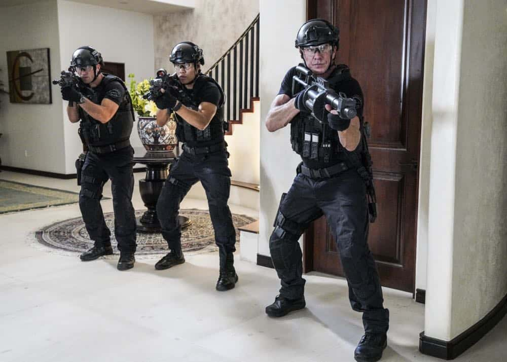 """Fire and Smoke"" -- The SWAT team is enlisted by Hondo's new romantic interest, Deputy District Attorney Nia Wells (Nikiva Dionne), to protect the jurors of a high-profile bribery trial, after some of them are targeted by organized crime in a series of fire-bombings, on S.W.A.T., Thursday, Oct. 11 (10:00-11:00 PM, ET/PT) on the CBS Television Network. Pictured L to R: Juan Javier Cardenas as Beni, David Lim as Victor Tan and Kenny Johnson as Dominique Luca. Photo: Bill Inoshita/CBS ©2018 CBS Broadcasting, Inc. All Rights Reserved"