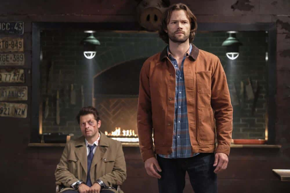 "Supernatural -- ""Stranger in a Strange Land"" -- Image Number: SN1401b_0175b.jpg -- Pictured (L-R): Misha Collins as Castiel and Jared Padalecki as Sam -- Photo: Bettina Strauss/The CW -- © 2018 The CW Network, LLC All Rights Reserved"