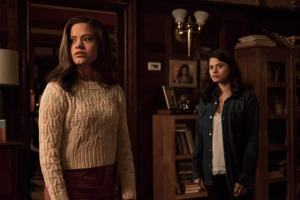 """Charmed -- """"Pilot""""-- Image Number: CMD101b_0102rb.jpg -- Pictured (L-R): Sarah Jeffery as Maggie Vera and Melonie Diaz as Mel Vera -- Photo: Katie Yu/The CW -- © 2018 The CW Network, LLC. All Rights Reserved."""