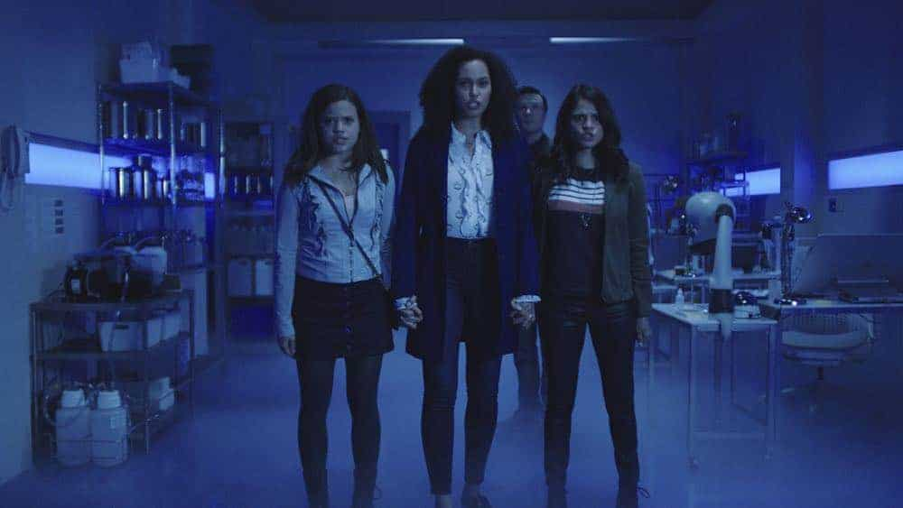 "Charmed -- ""Pilot""-- Image Number: CMD101g_0002r.jpg -- Pictured (L-R): Sarah Jeffery as Maggie Vera, Madeleine Mantock as Macy Vaughn, Rupert Evans as Harry Greenwood and Melonie Diaz as Mel Vera -- Photo: The CW -- © 2018 The CW Network, LLC. All Rights Reserved"