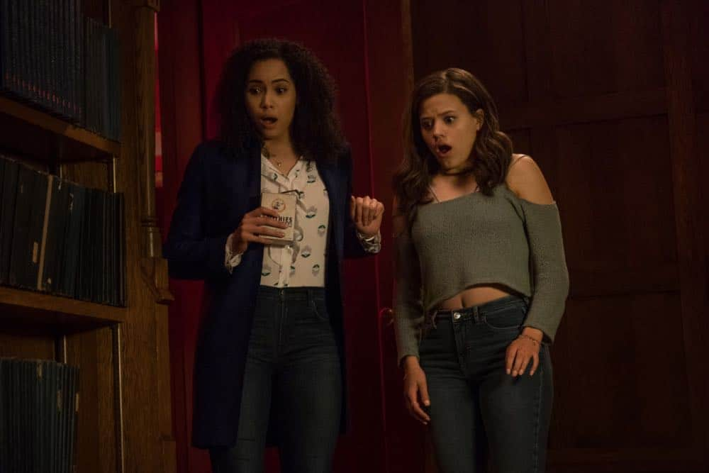 """Charmed -- """"Pilot""""-- Image Number: CMD101e_0244.jpg -- Pictured (L-R): Madeleine Mantock as Macy Vaughn and Sarah Jeffery as Maggie Vera -- Photo: Katie Yu/The CW -- © 2018 The CW Network, LLC. All Rights Reserved."""