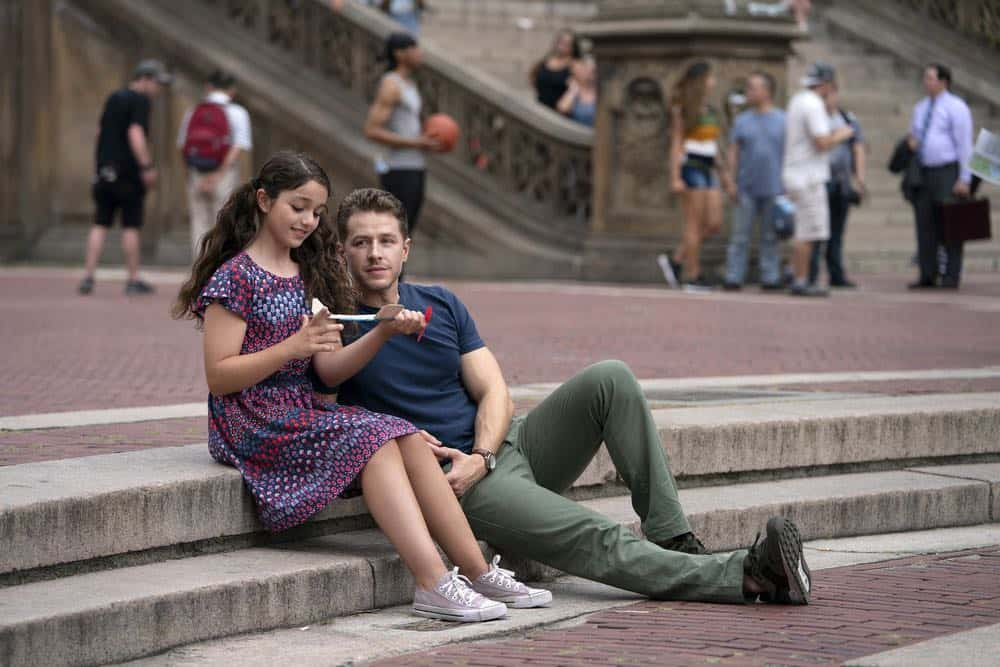 """MANIFEST -- """"Unclaimed Baggage"""" Episode 104 -- Pictured: (l-r) Jenna Kurmemaj as ten year-old Olive, Josh Dallas as Ben Stone, -- (Photo by: Peter Kramer/NBC/Warner Brothers)"""