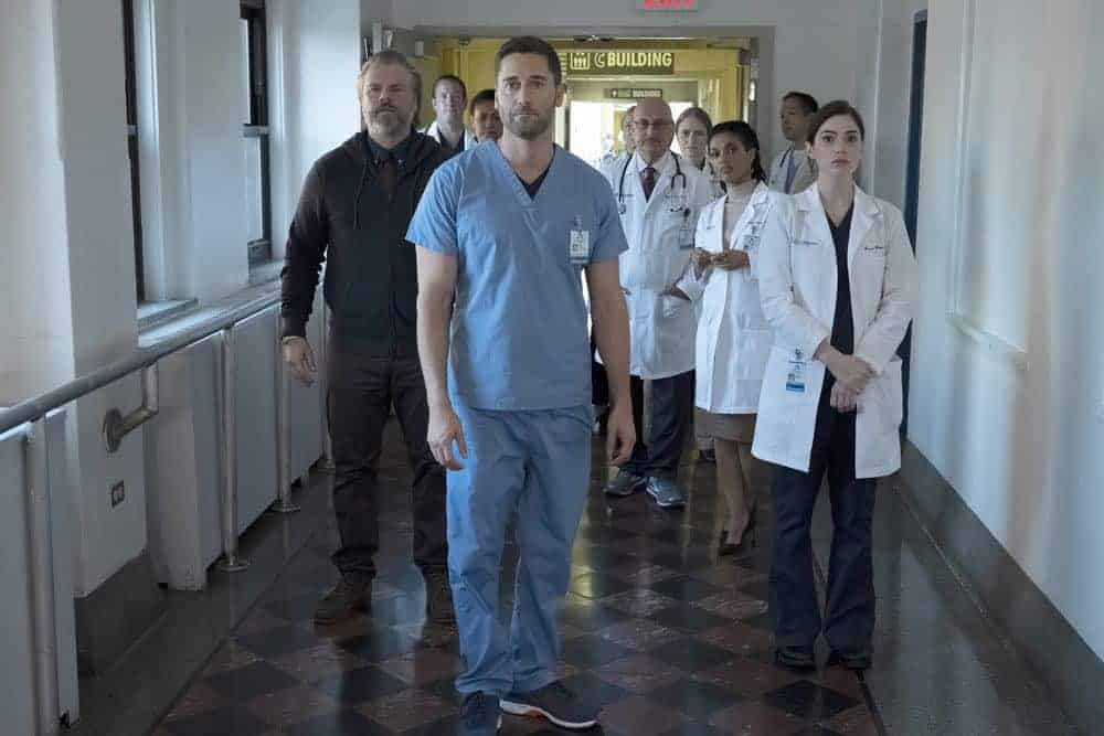 "NEW AMSTERDAM -- ""Boundaries"" Episode 104 -- Pictured: (l-r) Tyler Labine as Dr. Iggy Frome, Ryan Eggold as Dr. Max Goodwin, Anupam Kher as Dr. Vijay Kapoor, Freema Agyeman as Dr. Helen Sharpe, Janet Montgomery as Dr. Lauren Bloom -- (Photo by: Francisco Roman/NBC)"