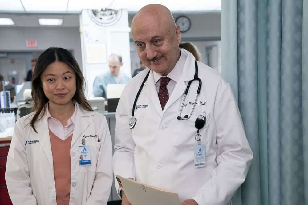 "NEW AMSTERDAM -- ""Boundaries"" Episode 104 -- Pictured: (l-r) Christine Chang as Agnes Kao, Anupam Kher as Dr. Vijay Kapoor -- (Photo by: Virginia Sherwood/NBC)"