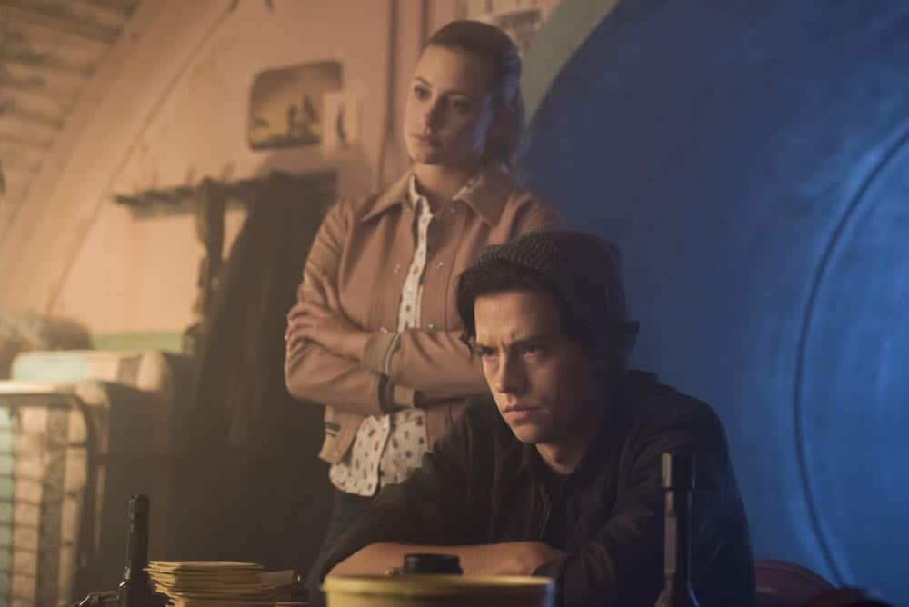 """Riverdale -- """"Chapter Thirty-Seven: Fortune and Men's Eyes"""" -- Image Number: RVD302a_0190.jpg -- Pictured (L-R): Lili Reinhart as Betty and Cole Sprouse as Jughead -- Photo: Dean Buscher/The CW -- © 2018 The CW Network, LLC. All rights reserved."""