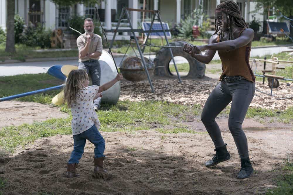 Andrew Lincoln as Rick Grimes, Chloe Garcia-Frizzi as Judith Grimes, Danai Gurira as Michonne - The Walking Dead _ Season 9, Episode 3 - Photo Credit: Gene Page/AMC