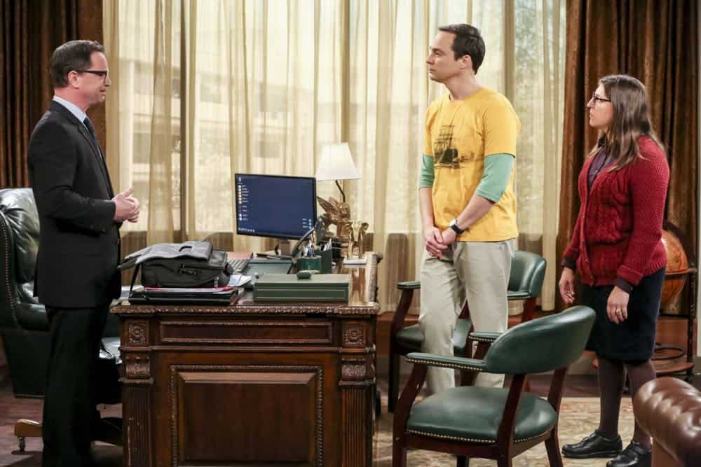 """The Planetarium Collision"" -- Pictured: President Siebert (Joshua Malina) , Sheldon Cooper (Jim Parsons) and Amy Farrah Fowler (Mayim Bialik). When Amy doesn't have time to work on super-asymmetry, Sheldon goes to great lengths to ensure she's available to work with him even it if means accidentally sabotaging her career in the process. Also, Koothrappali doesn't want Wolowitz to join him in hosting a show at the planetarium, on THE BIG BANG THEORY, Thursday, Oct. 18 (8:00-8:31 PM, ET/PT) on the CBS Television Network. Emmy Award winner Bob Newhart returns as Arthur Jeffries. Photo: Michael Yarish/Warner Bros. Entertainment Inc. © 2018 WBEI. All rights reserved."