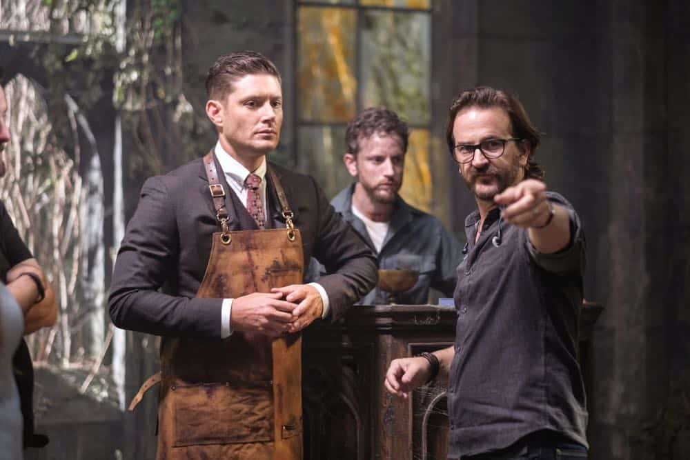 "Supernatural -- ""Gods and Monsters"" -- Image Number: SN1402A_BTS_0440b.jpg -- Pictured (L-R): Behind the scenes with Jensen Ackles as Dean/Michael and director Richard Speight, Jr. -- Photo: Robert Falconer/The CW -- © 2018 The CW Network, LLC All Rights Reserved"