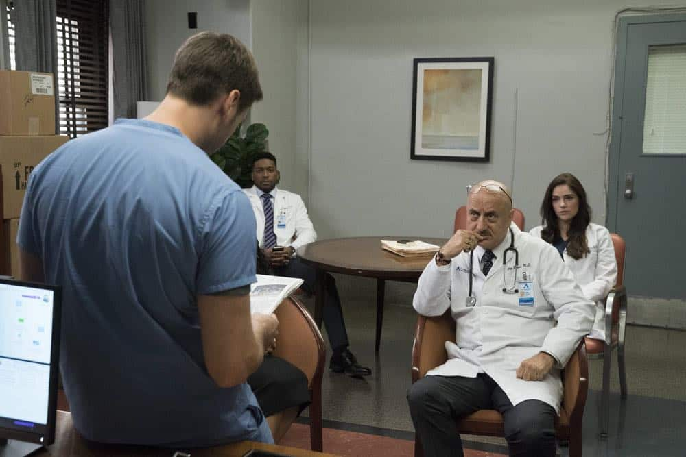 "NEW AMSTERDAM -- ""Cavitation"" Episode 105 -- Pictured: (l-r) Ryan Eggold as Dr. Max Goodwin, Jocko Sims as Dr. Floyd Reynolds, Anupam Kher as Dr. Vijay Kapoor, Janet Montgomery as Dr. Lauren Bloom -- (Photo by: Virginia Sherwood/NBC)"