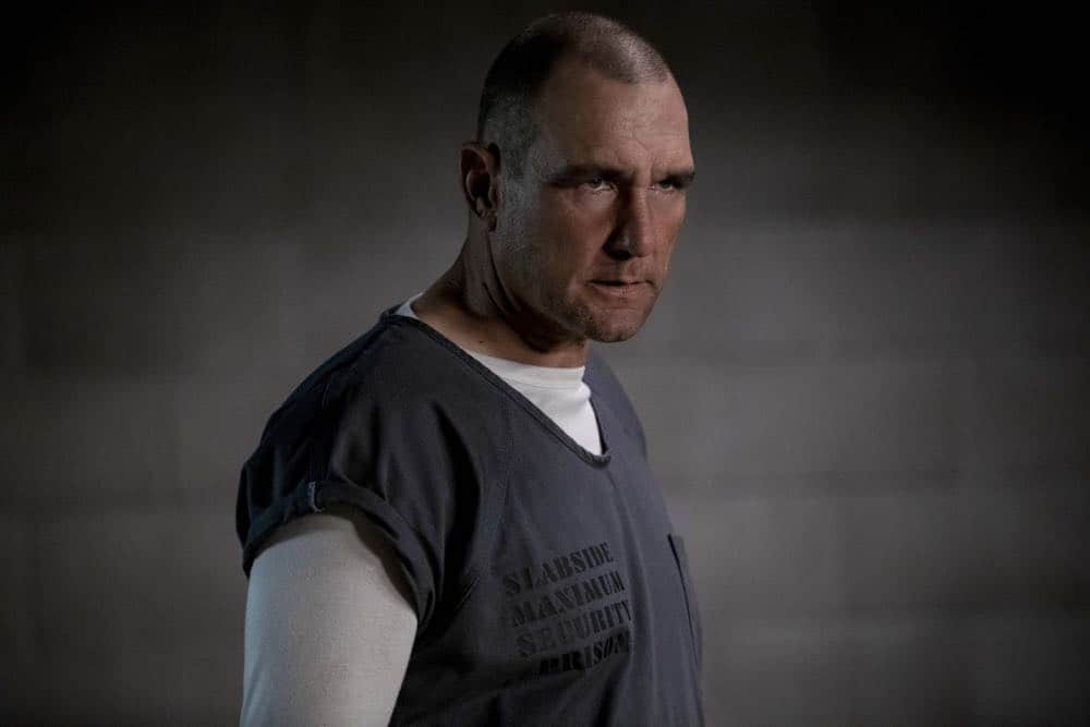 "Arrow -- ""Crossing Lines"" -- Image Number: AR703a_0108b -- Pictured: Vinnie Jones as Danny ""Brick"" Brickwell -- Photo: Jack Rowand/The CW -- © 2018 The CW Network, LLC. All Rights Reserved."