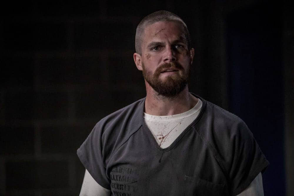 "Arrow -- ""Crossing Lines"" -- Image Number: AR703a_0256b -- Pictured: Stephen Amell as Oliver Queen/Green Arrow -- Photo: Jack Rowand/The CW -- © 2018 The CW Network, LLC. All Rights Reserved."