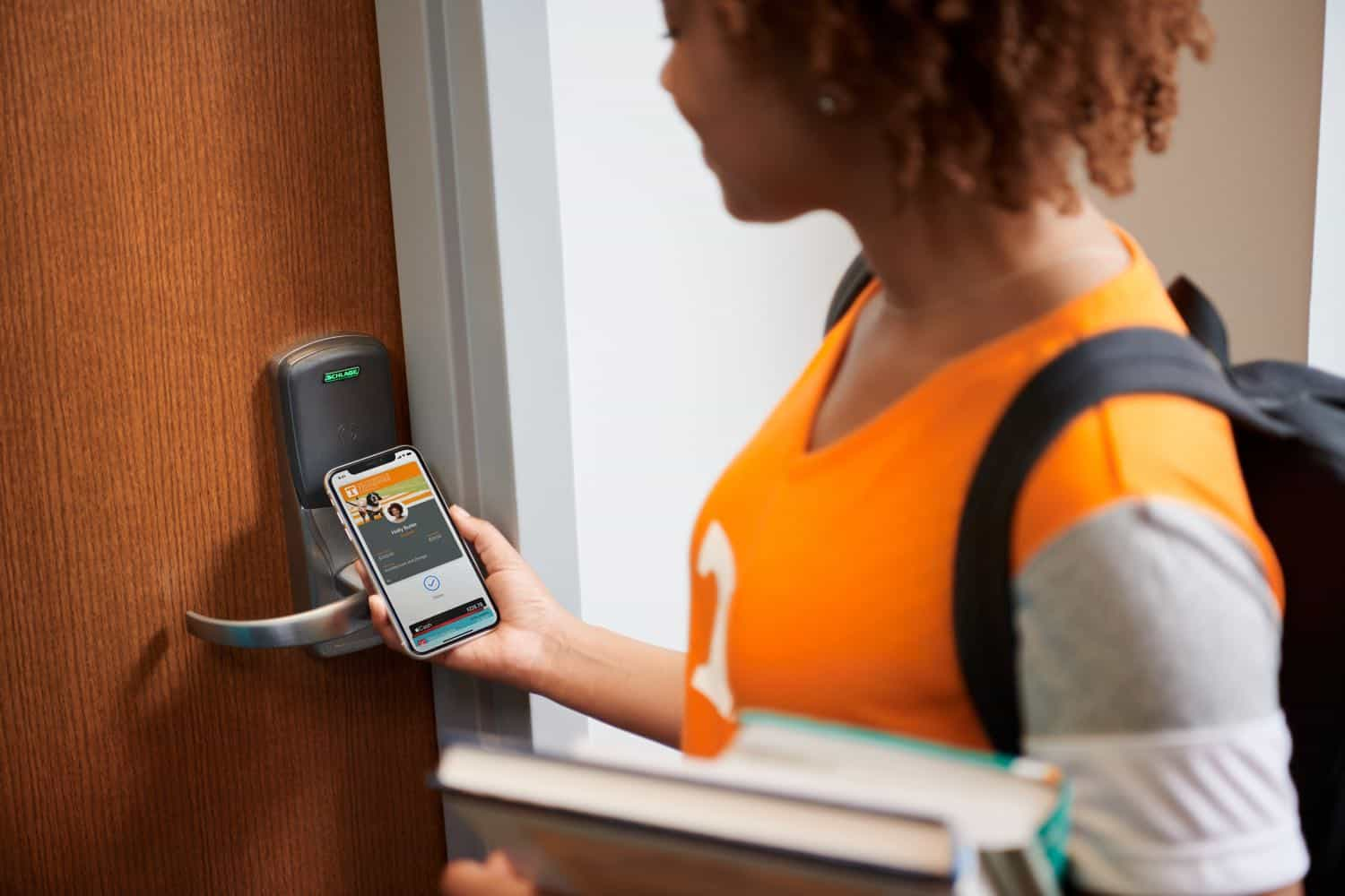 Apple brings student IDs to iPhone and Apple Watch student unlocking door with iPhone 081319