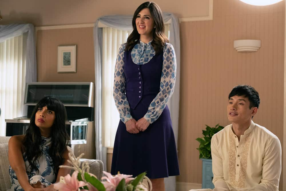 "THE GOOD PLACE -- ""A Girl From Arizona"" Episode 401/402 -- Pictured: (l-r) Jameela Jamil as Tahani, D'Arcy Carden as Janet, Manny Jacinto as Jason -- (Photo by: Colleen Hayes/NBC)"