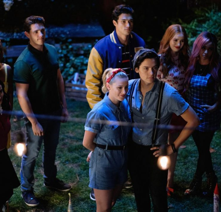 "Riverdale -- ""Chapter Fifty-Eight: In Memoriam"" -- Image Number: RVD401b_0209.jpg -- Pictured (L-R): Camila Mendes as Veronica, Ashleigh Murray as Josie, Casey Cott as Kevin, Charles Melton as Reggie, Lili Reinhart as Betty, Cole Sprouse as Jughead, Madelaine Petsch as Cheryl and Vanessa Morgan as Toni -- Photo: Robert Falconer/The CW -- © 2019 The CW Network, LLC. All Rights Reserved."