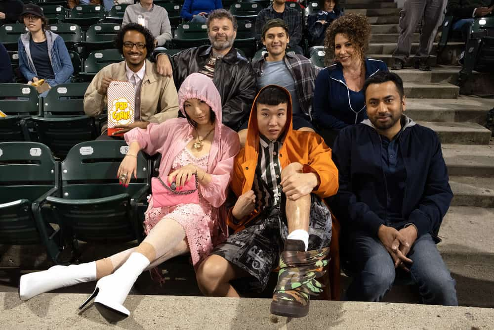 "SUNNYSIDE -- ""Pilot"" Episode -- Pictured: (Back Row l-r) Samba Schutte as Hakim, Tudor Petrut as Drazen, Moses Storm as Brady, Diana Marie Riva as Griselda,(Front Row l-r) Poppy Liu as Mei Lin, Joel Kim Booster as Jun Ho, Kal Penn as Garrett -- (Photo by: Colleen Hayes/NBC)"