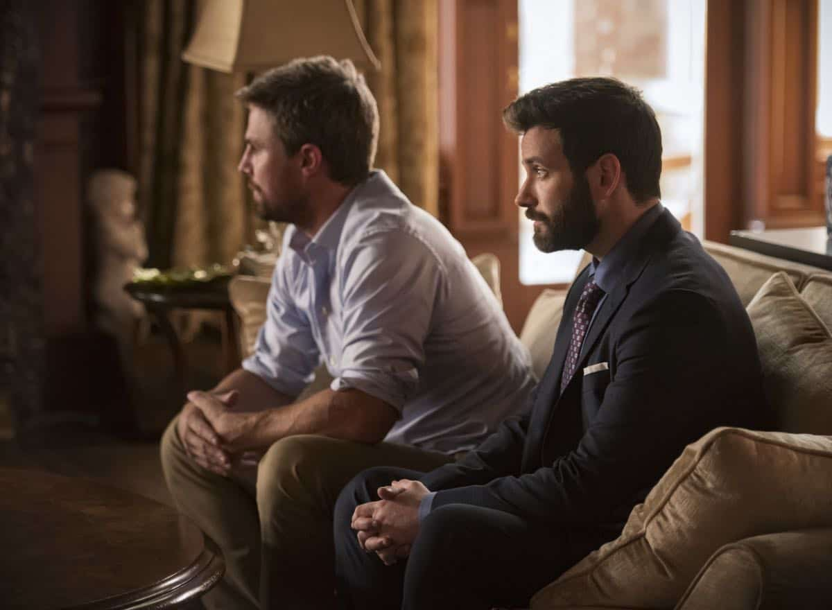 "Arrow -- ""Starling City"" -- Image Number: AR801a_0170b.jpg -- Pictured (L-R): Stephen Amell as Oliver Queen/Green Arrow and Colin Donnell as Tommy Merlyn -- Photo: Dean Buscher/The CW -- © 2019 The CW Network, LLC. All Rights Reserved."