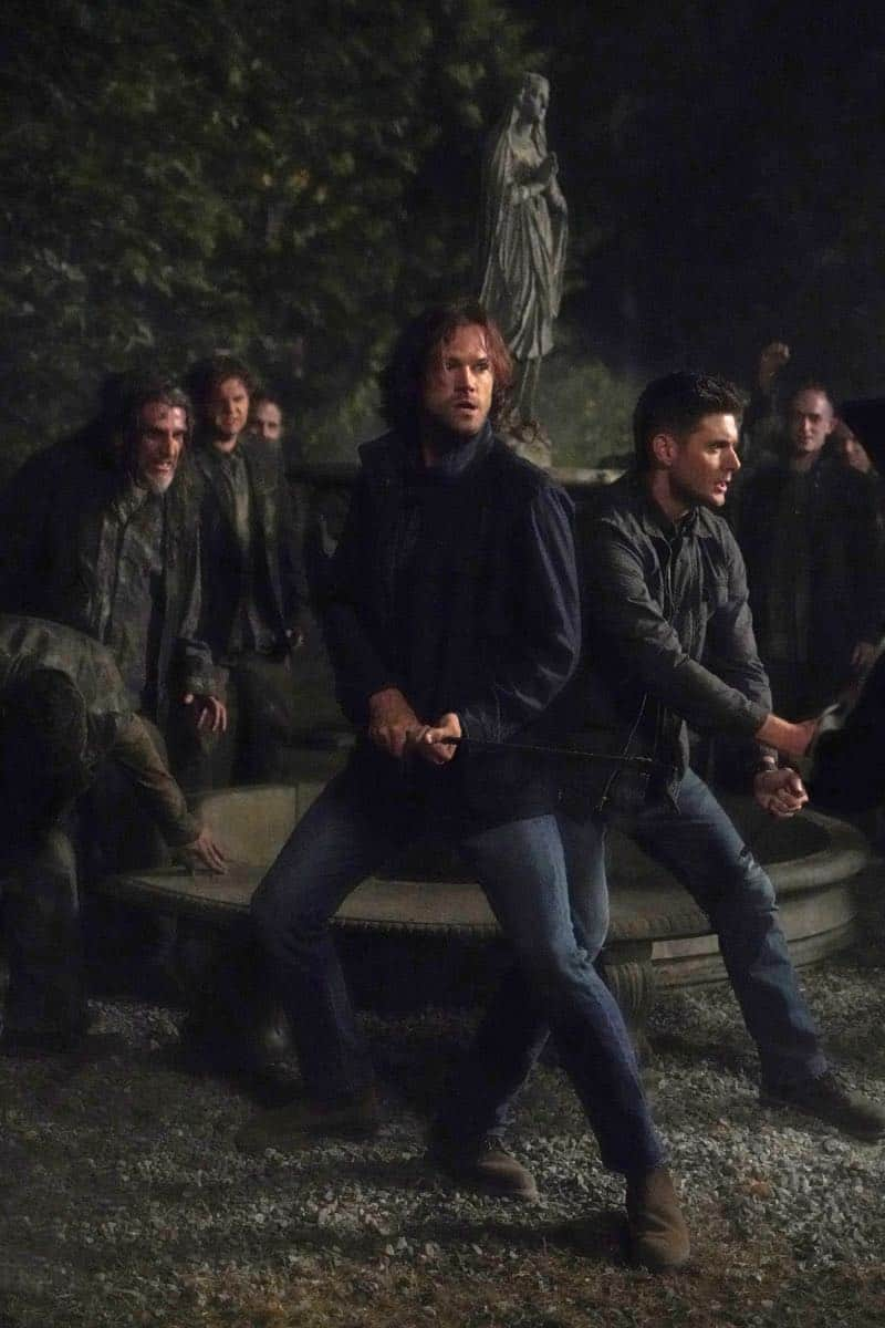 "Supernatural -- ""Back and to the Future"" -- Image Number: SN1502b_0176r.jpg -- Pictured (L-R): Jared Padalecki as Sam and Jensen Ackles as Dean -- Photo: Shane Harvey/The CW -- © 2019 The CW Network, LLC. All Rights Reserved."