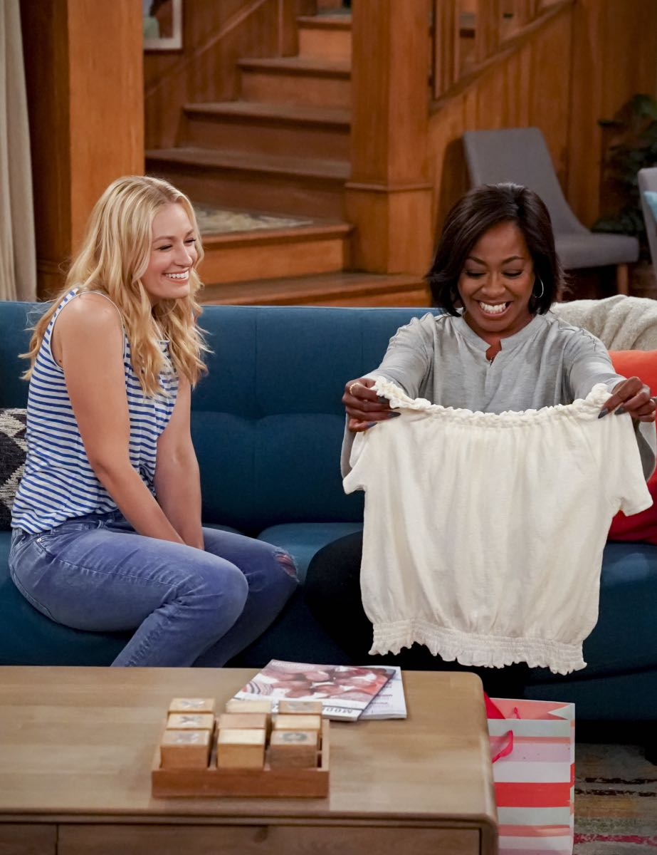 """Welcome to the Re-Rack"" - Pictured: Beth Behrs (Gemma Johnson) and Tichina Arnold (Tina Butler). One year after the Johnsons moved next door to the Butlers, Dave is eager to take on a bigger role in Calvin's annual Yardecue and prove how much a part of the community he's become. But Calvin's reaction makes it clear that, while the relationship between the two families has grown, the friendship between Calvin and Dave still has a way to go, on the second season premiere of THE NEIGHBORHOOD, Monday, Sept. 23 (8:00-8:30 PM, ET/PT) on the CBS Television Network. Photo: Monty Brinton/CBS ©2019 CBS Broadcasting, Inc. All Rights Reserved."
