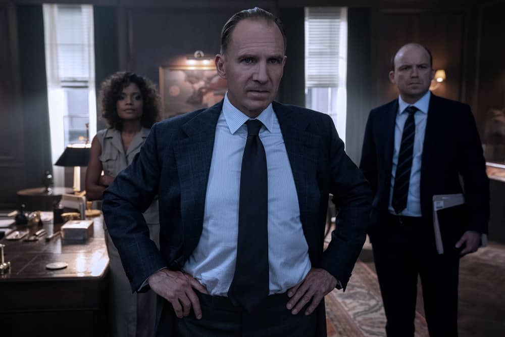 M (Ralph Fiennes), Moneypenny (Naomie Harris) and Tanner (Rory Kinnear)  in a tense moment in M's office in  NO TIME TO DIE,  a DANJAQ and Metro Goldwyn Mayer Pictures film. Credit: Nicola Dove © 2019 DANJAQ, LLC AND MGM.  ALL RIGHTS RESERVED.