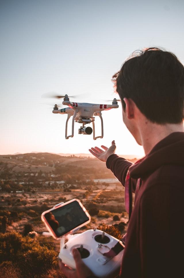 man holding quadcopter remote 3072101