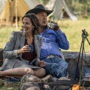 """(L-R) Wendy Moniz-Grillo as Governor Perry and Kevin Costner as John Dutton. Episode 4 of Yellowstone- """"Going Back to Cali"""" premieres July 12 at 9 P.M. ET/PT on Paramount Network."""